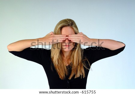 Woman with both hands over her eyes. - stock photo