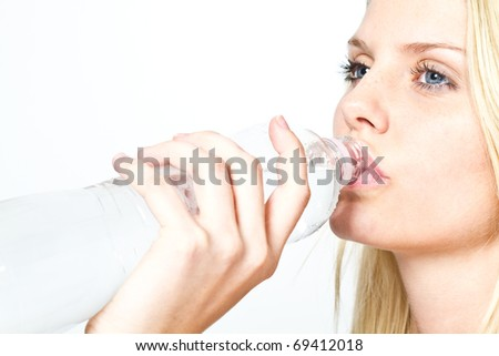 woman with bottle of water - stock photo
