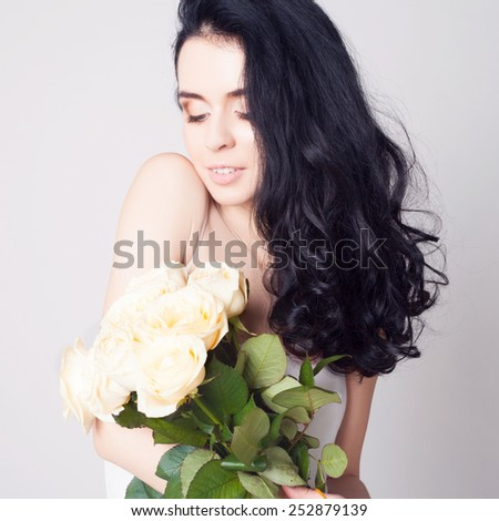 Woman with bouquet of white roses.  - stock photo
