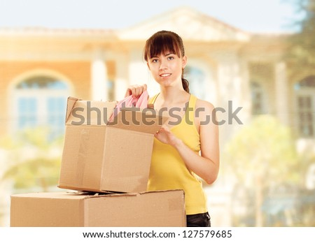 Woman with box moving