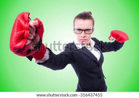 Woman with boxing gloves on white - stock photo