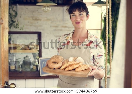 Woman With Bread At Pastry Shop Order