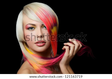 Woman with bright make-up and multi-coloured strand in hair - stock photo