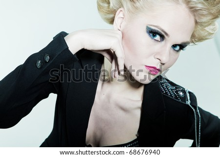 woman with bright makeup on eyes with his hands for the person - stock photo