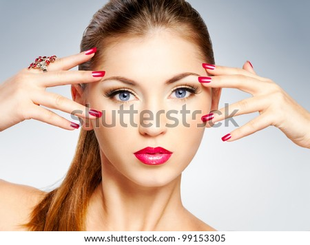 Woman with bright red lips and nail - stock photo