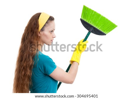 woman with broom isolated on a white background - stock photo