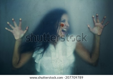 woman with bruises victim of domestic violence or accident shot against Grained Glass - stock photo
