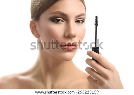 woman with brush for eyelashes - stock photo