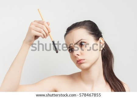 woman with brush for makeup on white background..