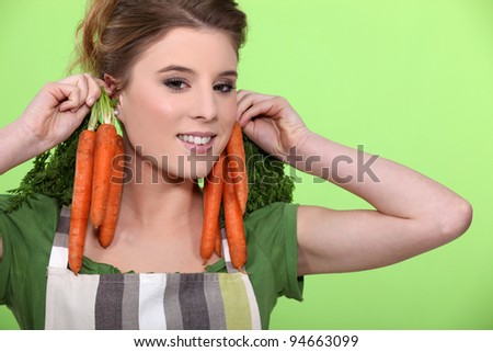 Woman with bunches of carrots - stock photo