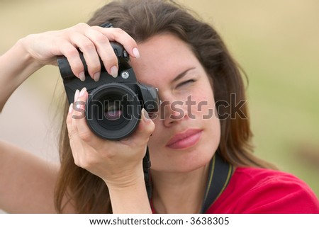 Woman with camera. Hobby photographer