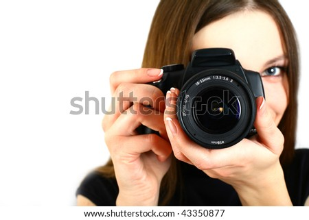Woman with camera isolated on white background