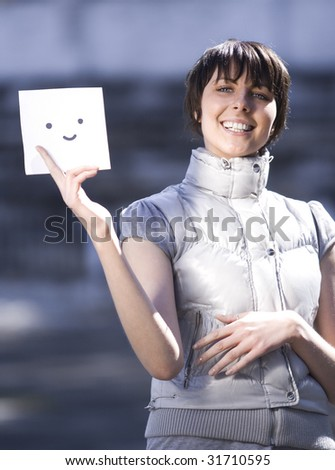 Woman with card outdoor - stock photo