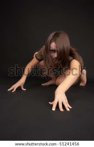 Woman with cat-like face art looking crafty - stock photo