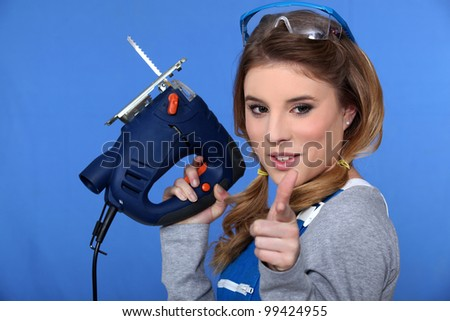 Woman with chain saw - stock photo