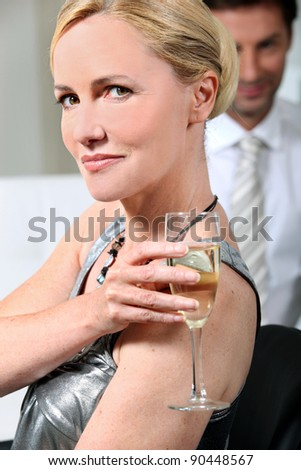 Woman with champagne flute - stock photo