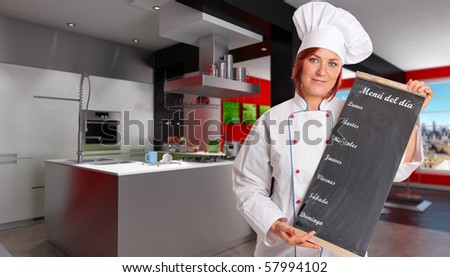 Woman with chef attire holding a blackboard with weekly menu in a modern domestic kitchen