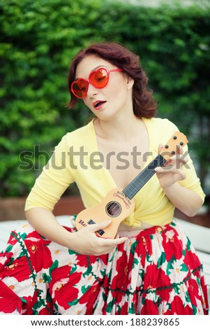 Woman with child guitar - stock photo