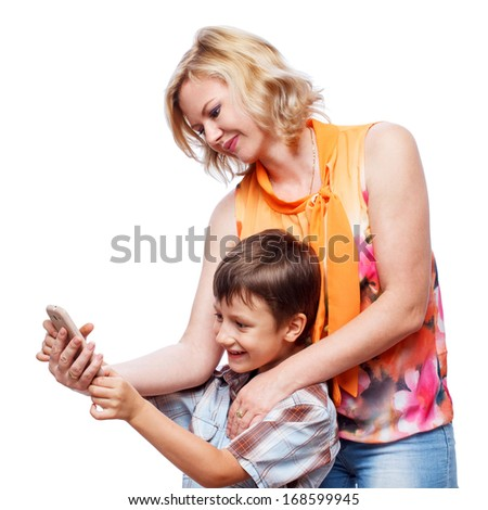 Woman with child playing on smartphone, isolated on white - stock photo