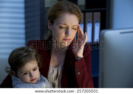 Woman with child working in the office - stock photo