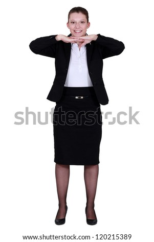 Woman with chin on hands - stock photo