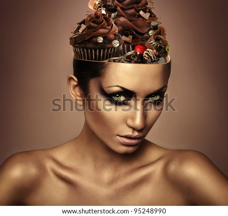 woman with chocolate in head - stock photo