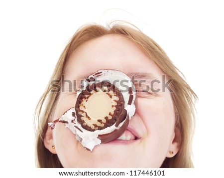 Woman with chocolate marshmallow in the face
