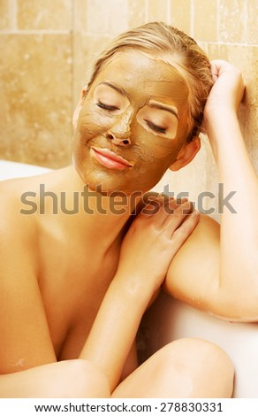 Woman with chocolate mask based on a bath by elbow. - stock photo