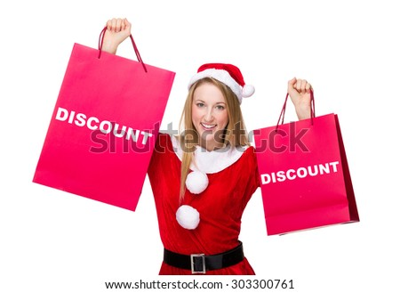 Woman with christmas costume hold with shopping bag and showing a word discount - stock photo