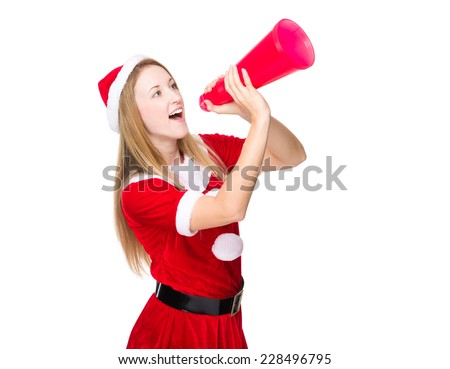 Woman with Christmas dress yell with megaphone - stock photo