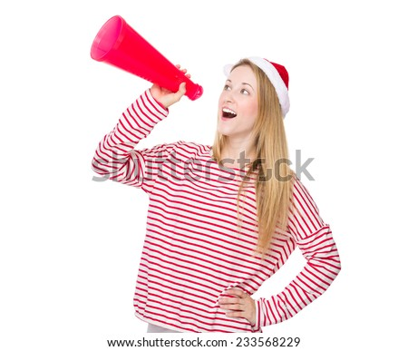 Woman with christmas hat and yell with megaphone - stock photo