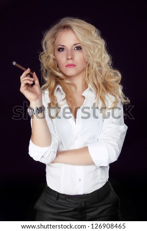Woman with Cigar Exhaling Smoke on Dark Background, Men style - stock photo