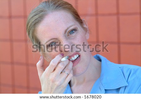 woman with cigarette - stock photo