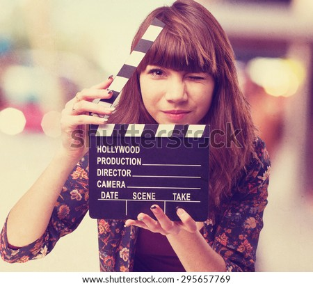 woman with clapper - stock photo