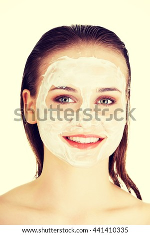 Woman with clay facial mask - stock photo