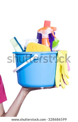 woman with cleaning equipment ready to clean house
