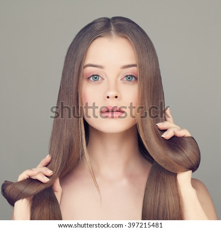 Woman with Clear Skin and Long Healthy Hairstyle - stock photo