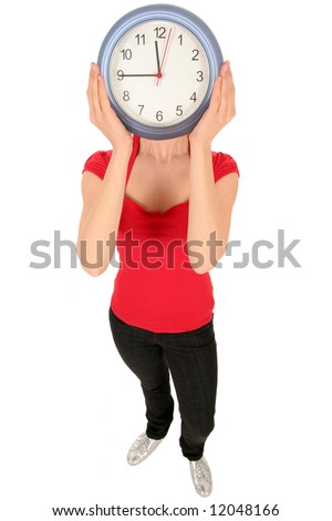 Woman with clock covering face - stock photo