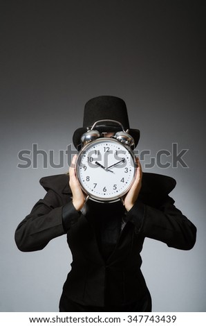 Woman with clock in business concept