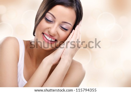 Woman with closed eyes enjoying in her healthy skin - stock photo