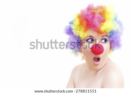 Woman with clown wig on white background - stock photo