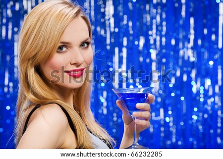 Woman with cocktail - stock photo