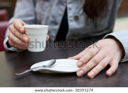 Woman with coffee close-up - stock photo