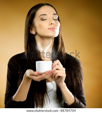 Woman with coffee cup on a brown background. - stock photo