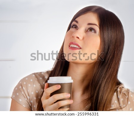 Woman with Coffee in  Cup indoors. Selective focus