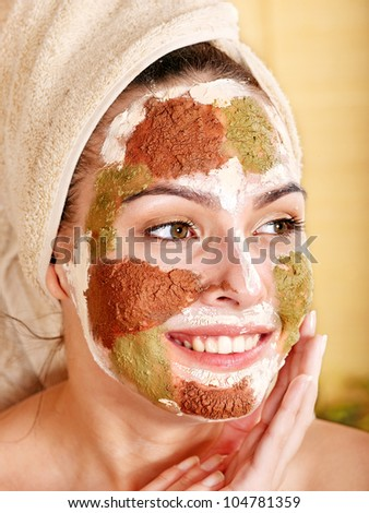 Woman with color clay facial mask. - stock photo