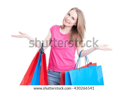 Woman with colored shopping bags acting cheerful and smiling while enjoying shopping isolated on white background - stock photo