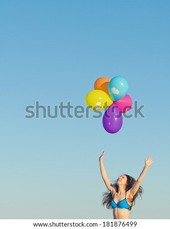 Woman with colorful balloons. Place for text. - stock photo