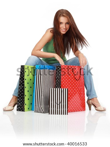 woman with colorful shopping bags in her hand - stock photo
