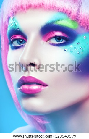 woman with colourful make-up and pink hairstyle
